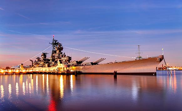USS New Jersey battleship at sunset
