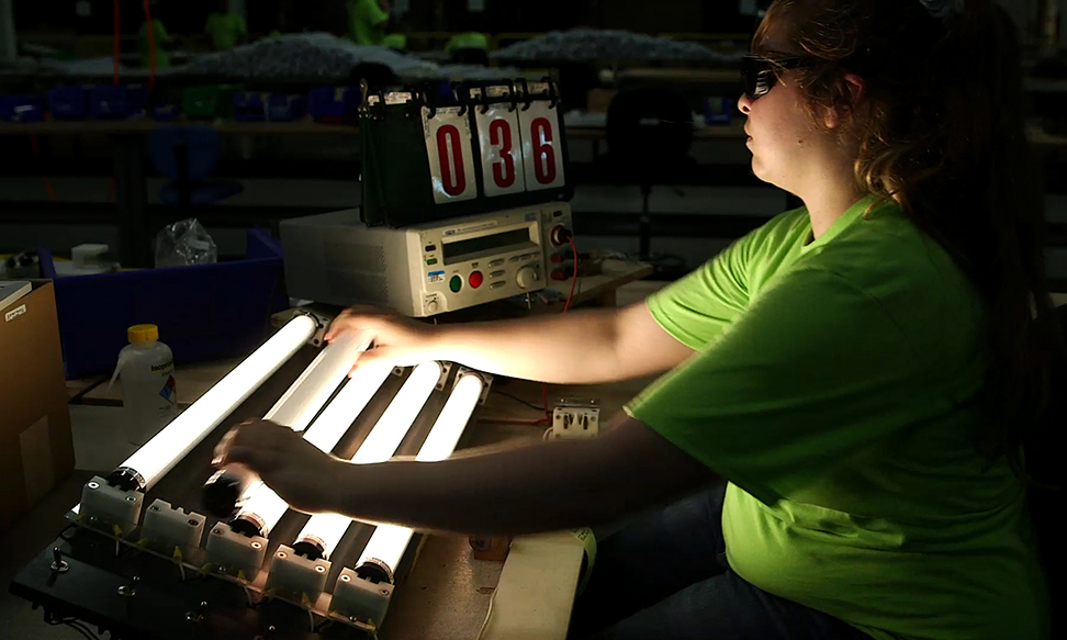 production worker performing light up test on M1