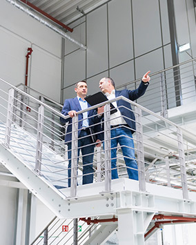 building specifiers standing on a staircase