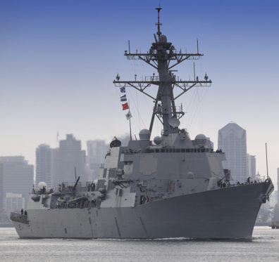 class guided missile destroyer leaving port